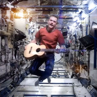 Hadfield w/ guitar in zero gravity picture