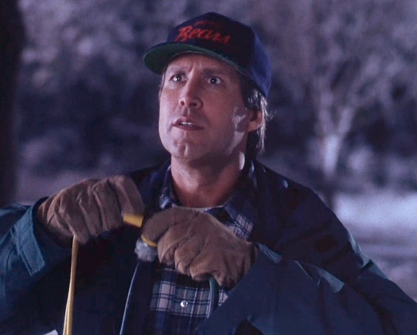Chevy Chase as Clark Griswold tests his xmas lights handiwork