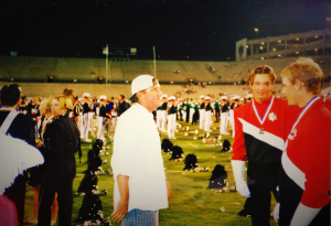 My best portrait of my favorite teacher, Myron Rosander in profile, on the field at dci finals retreat in 1997.